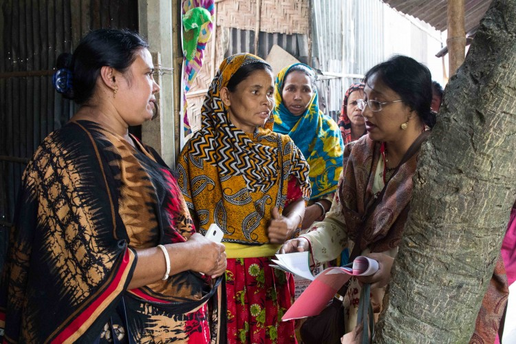 UHSSP staff talking about the common health care entitlement card, Bangladesh