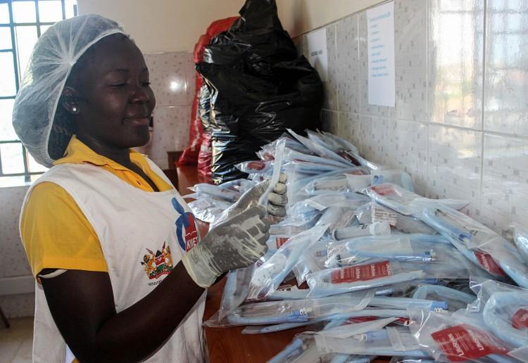 Assembling UBT parts at the KMET centre for Maternal Health Innovations unit