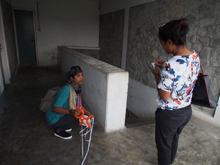 Salina (civil engineer) and Renu (architect) checking building dimensions